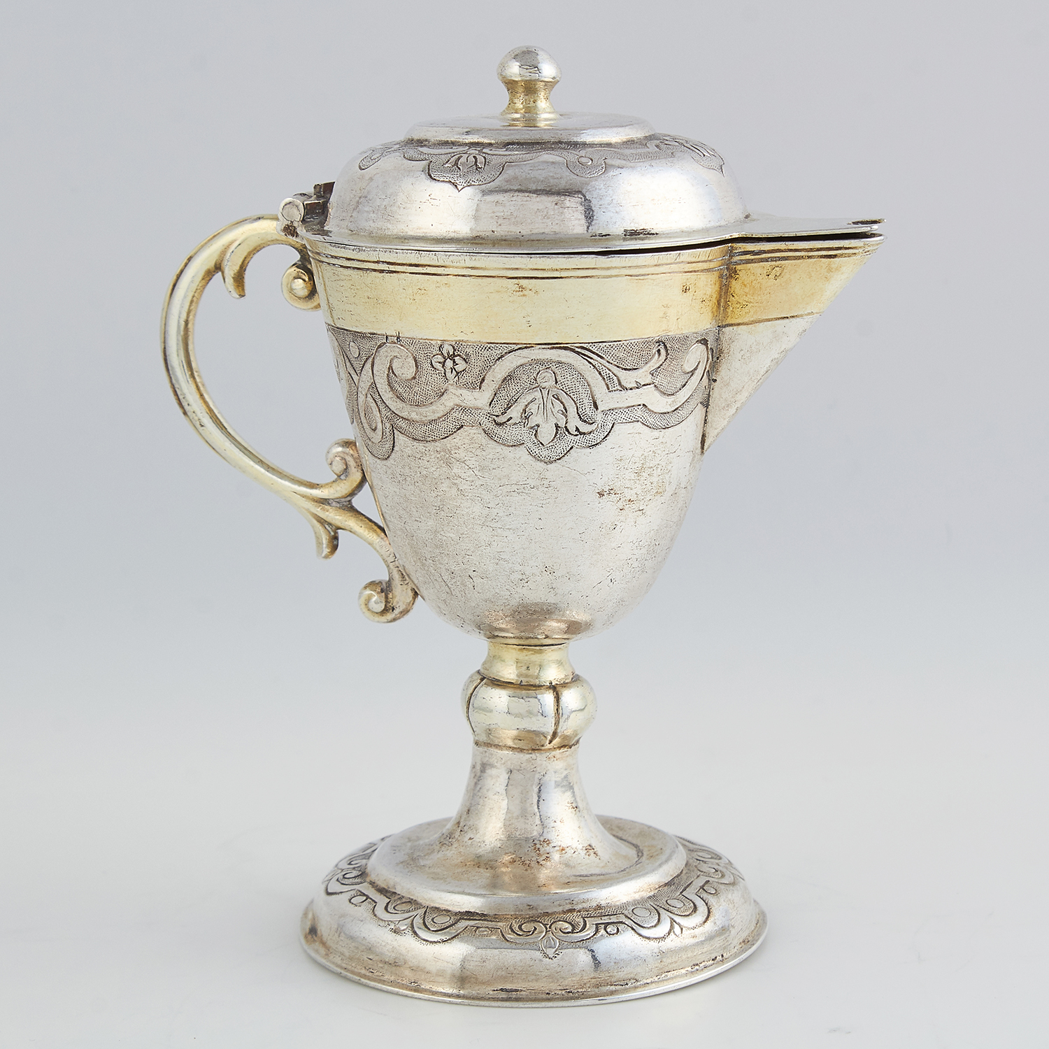 ANTIQUE GERMAN PARCEL GILT SILVER MINIATURE FLAGON the rounded tapering body atop a spreading