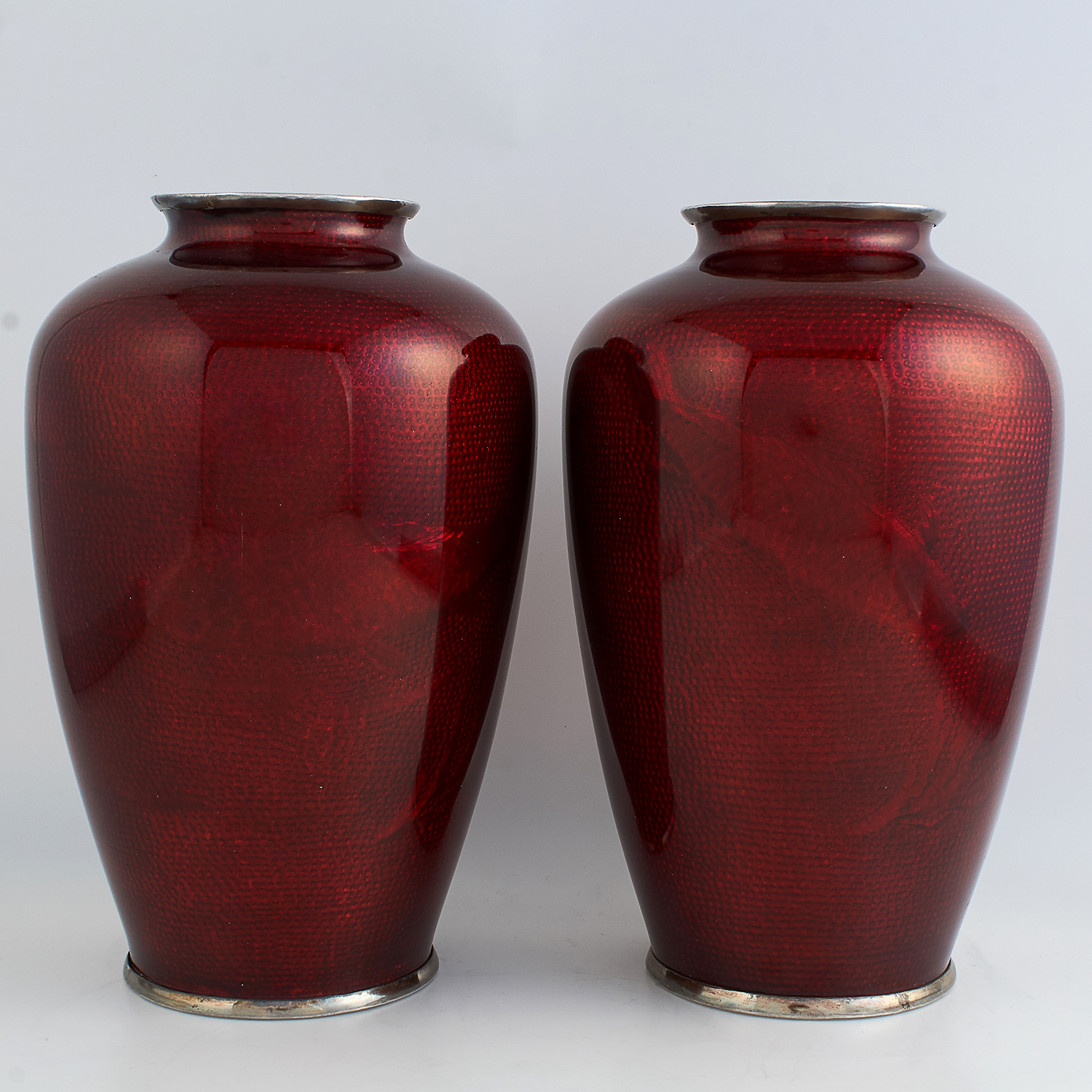 PAIR OF ANTIQUE SILVER AND ENAMEL VASES CIRCA 1920 the tapering rounded bodies decorated in red