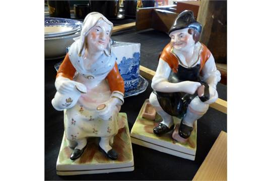 fa5d28badc4d1 Two 20th century Staffordshire figurines, The Cobbler and The ...