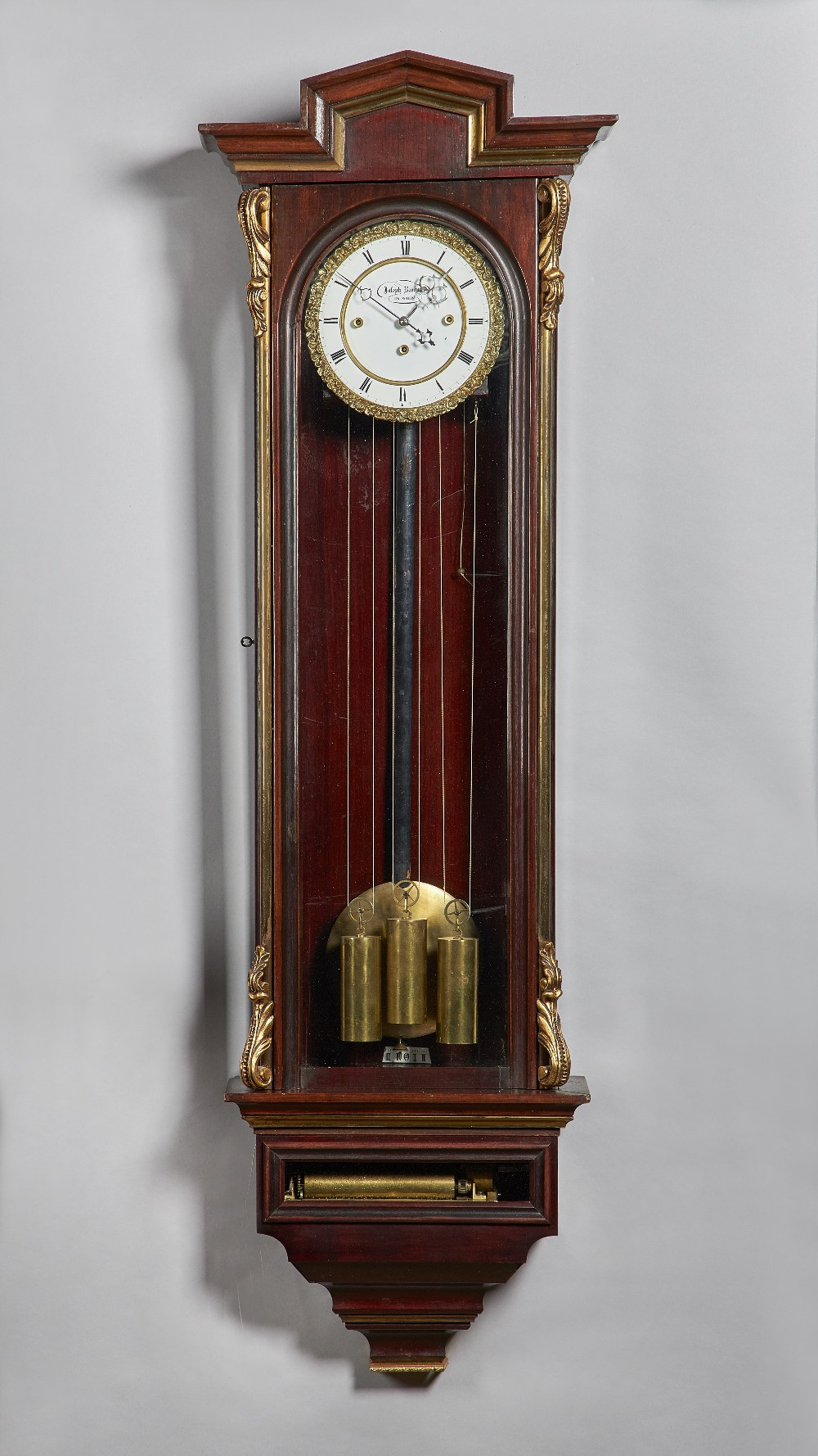 Lot 708 - A Viennese parcel-gilt mahogany three-train quarter chiming regulator with music box By Joseph
