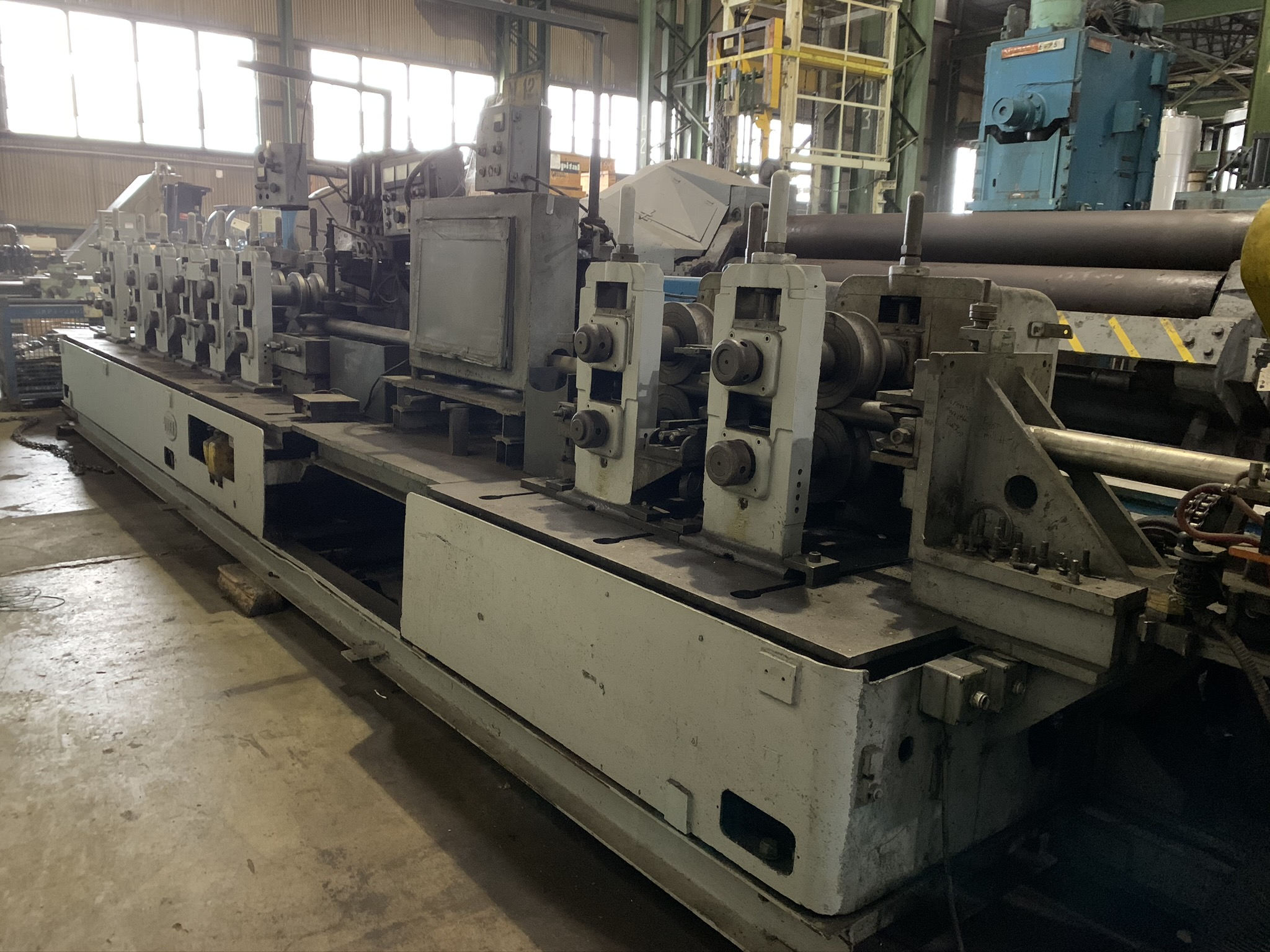 YODER MODEL M3 TUBE MILL; S/N 39774 68259-1, 9-STAND 7-DRIVEN FORMING STANDS, (2) SIZING STANDS,