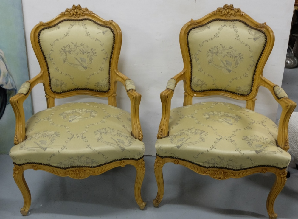 Lot 20 - Matching Pair of Carved Limewood Salon Armchairs, the padded seat covered with musical patterns,