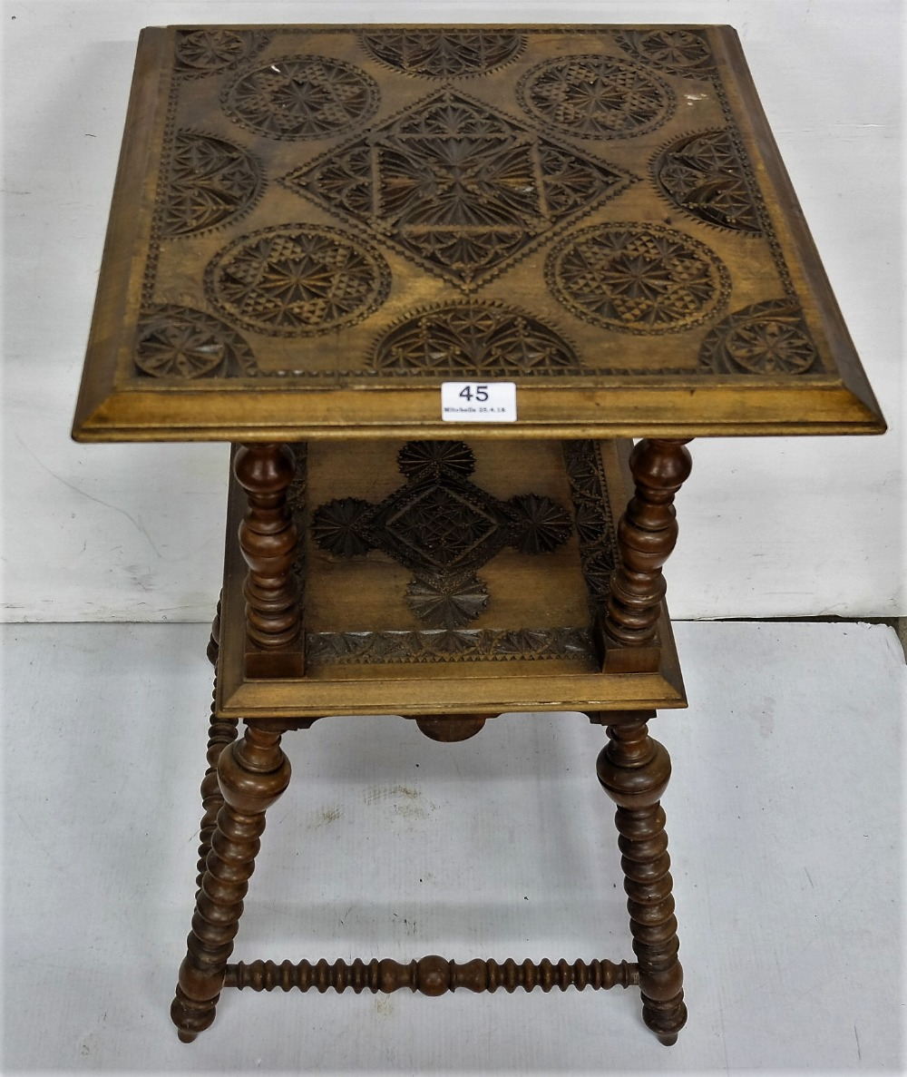 Lot 45 - Walnut 2-tiered occasional table with a carved top and centre, bobbin twist legs and stretchers, 17""