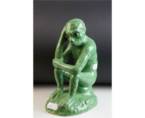 In the manner of Galle, Mosanic Green Glazed Pottery Seated Monkey with Glass Eyes, painted mark to base, 19cms high