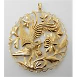 A bright yellow metal phoenix pendant with Chinese stamps to the reverse, diameter approx 6cm,
