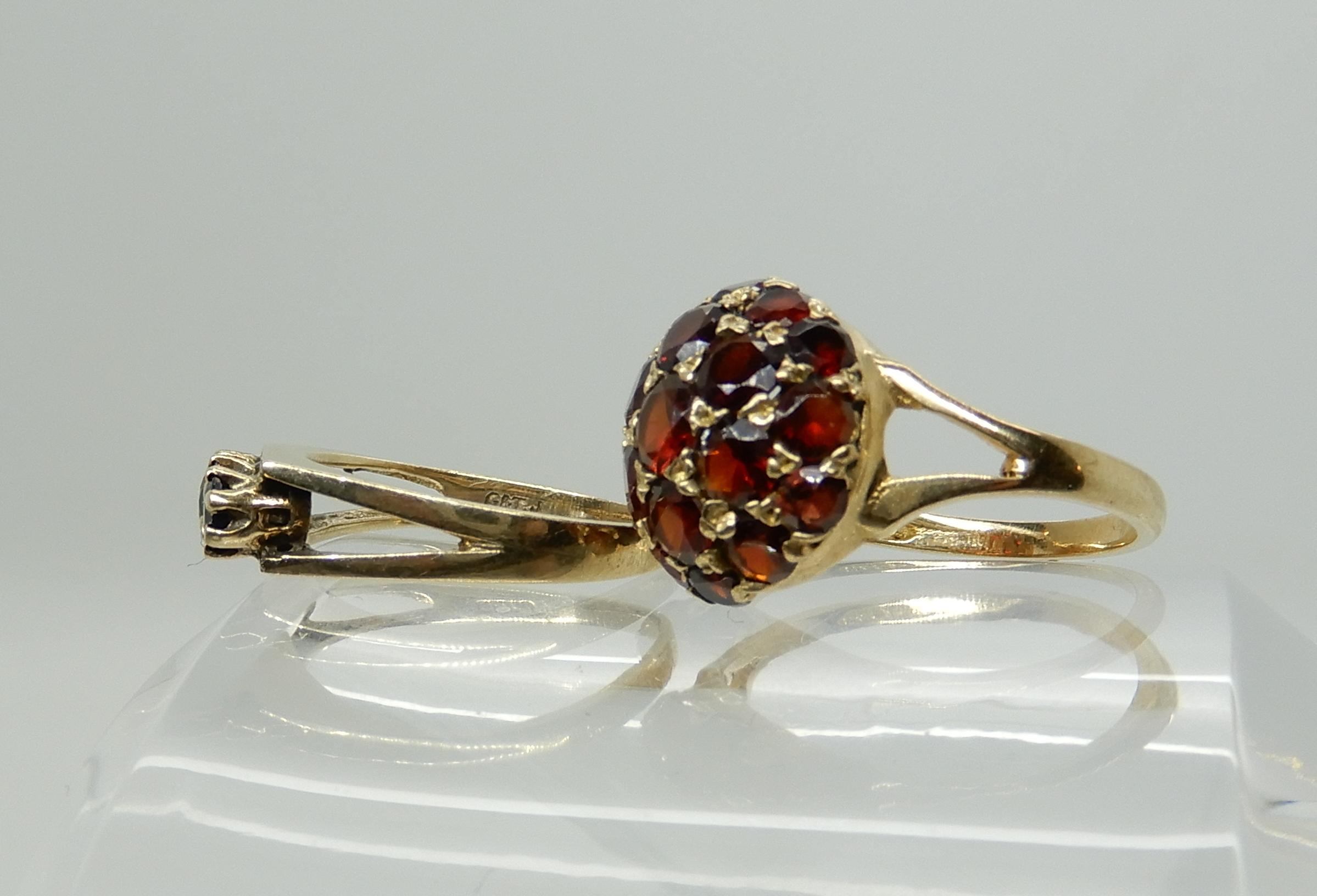 Lot 15 - A 9ct gold garnet set dome ring, size O1/2, together with a retro sapphire set ring size L1/2,