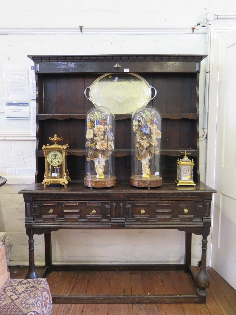 Lot 36 - A late 17th century oak dresser and rack, the stepped two tier rack with later parts, over a dresser