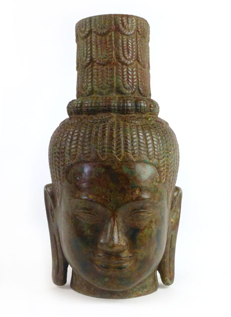 Lot 125 - A cast bronze Cambodian prince head, possibly from a temple.