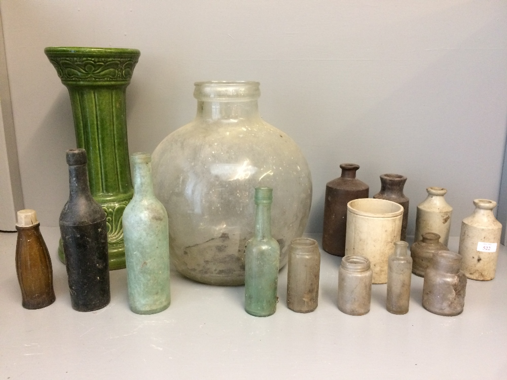 Lot 116 - Quantity of earthenware bottles, a green plant stand & a large bulbous glass vase
