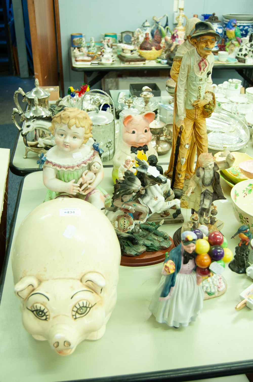 Lot 434 - A LARGE TINTED BISQUE FIGURE OF A SEATED FIRL WITH DOLL, TWO PIG MONEY BANKS, A LEONARDO LADY WITH