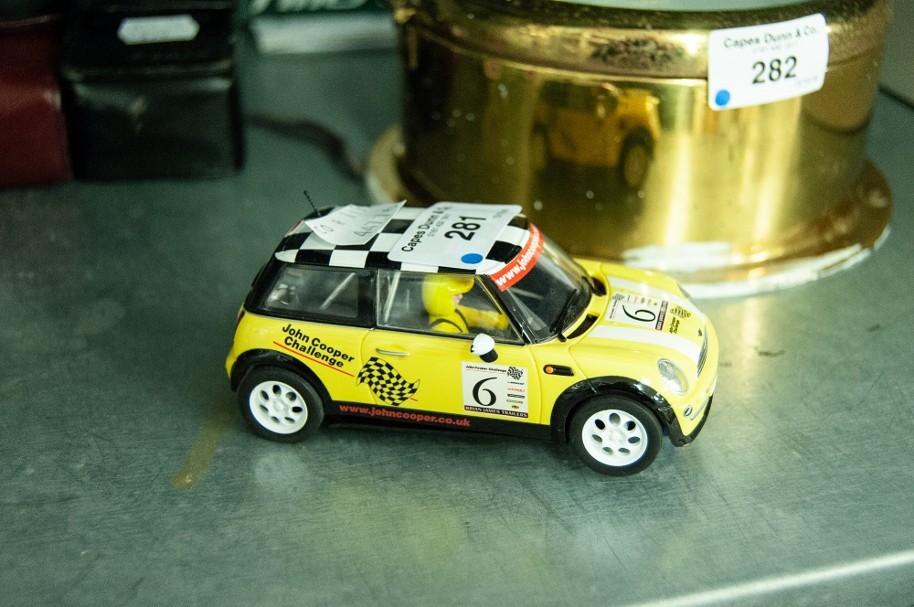 "Lot 281 - HORNBY (MADE IN CHINA) BATTERY OPERATED PLASTIC MODEL OF A MINI COOPER, 4 1/2"" LONG"