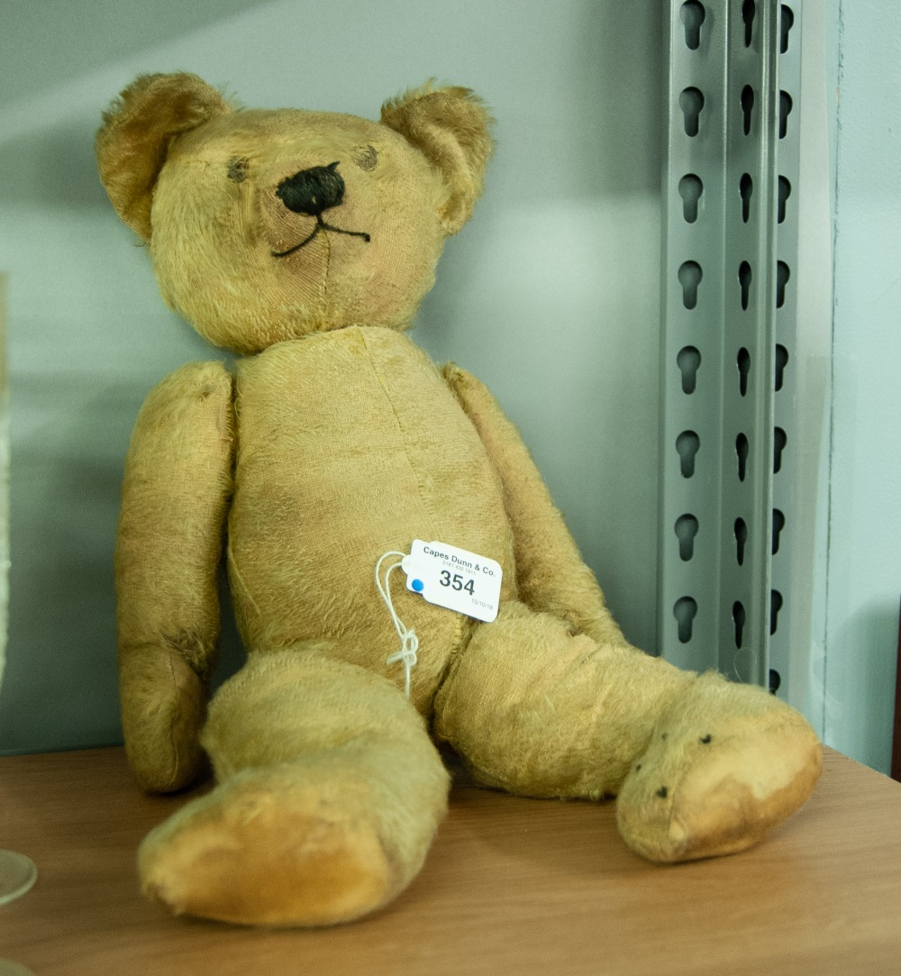 Lot 354 - PRE-WAR GOLDEN PLUSH TEDDY BEAR in original but well-loved condition with stitched detail, swivel