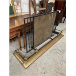Wrought iron spark guard (length 91cms) together with a brass fender, 133 x 38cms.