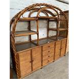 Rattan display unit over 4 drawers flanked by 2 cupboards, 217 x 53 x 196cms.