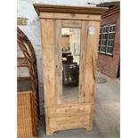 Pine single wardrobe with mirror door and 2 drawers to base.
