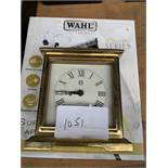 Quartz carriage clock together with WAHL corded clippers.