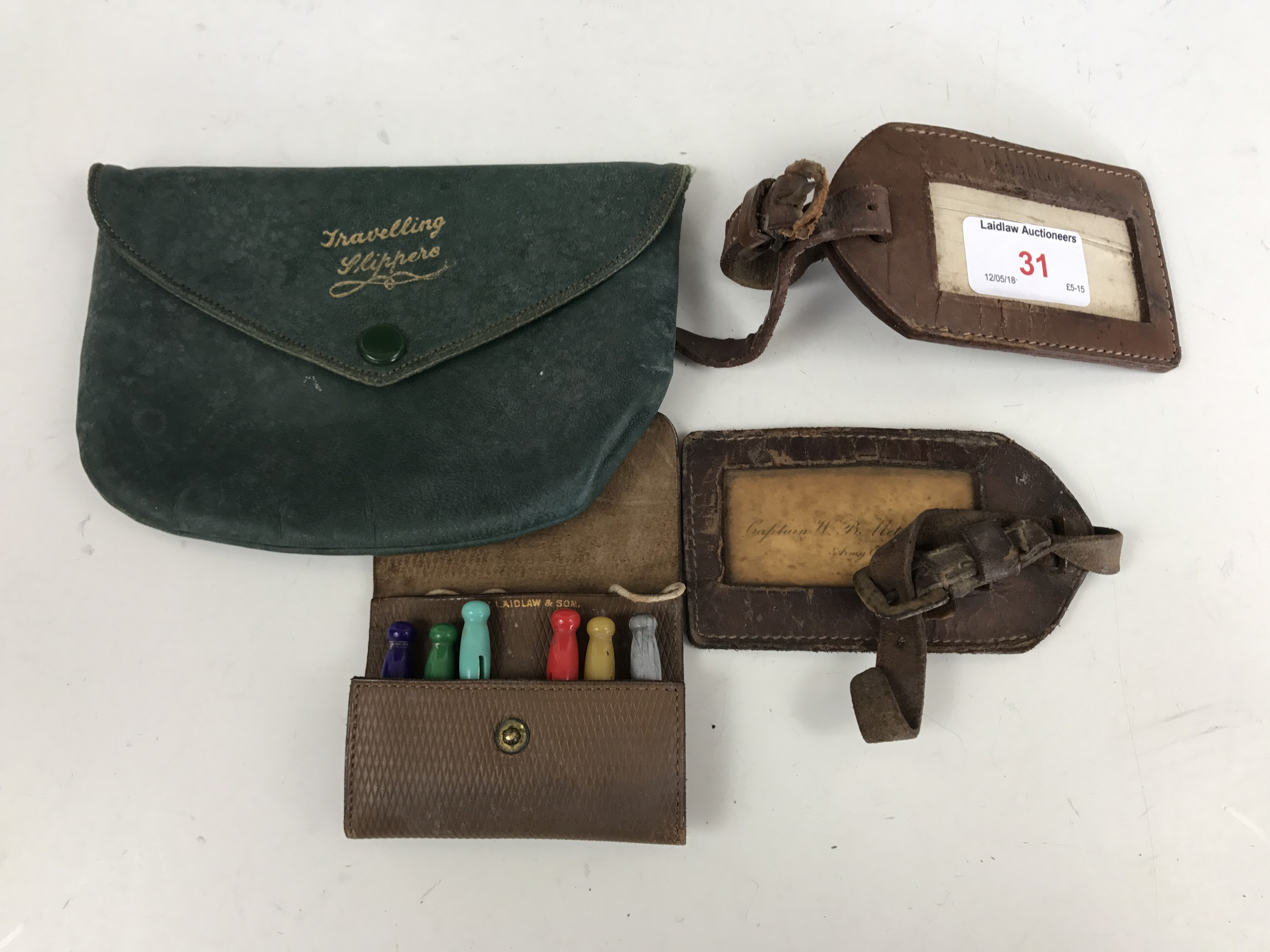 """Lot 31 - Vintage leather luggage tags, a leather """"Slippers"""" pouch and a cased set of travelling dolly pegs"""