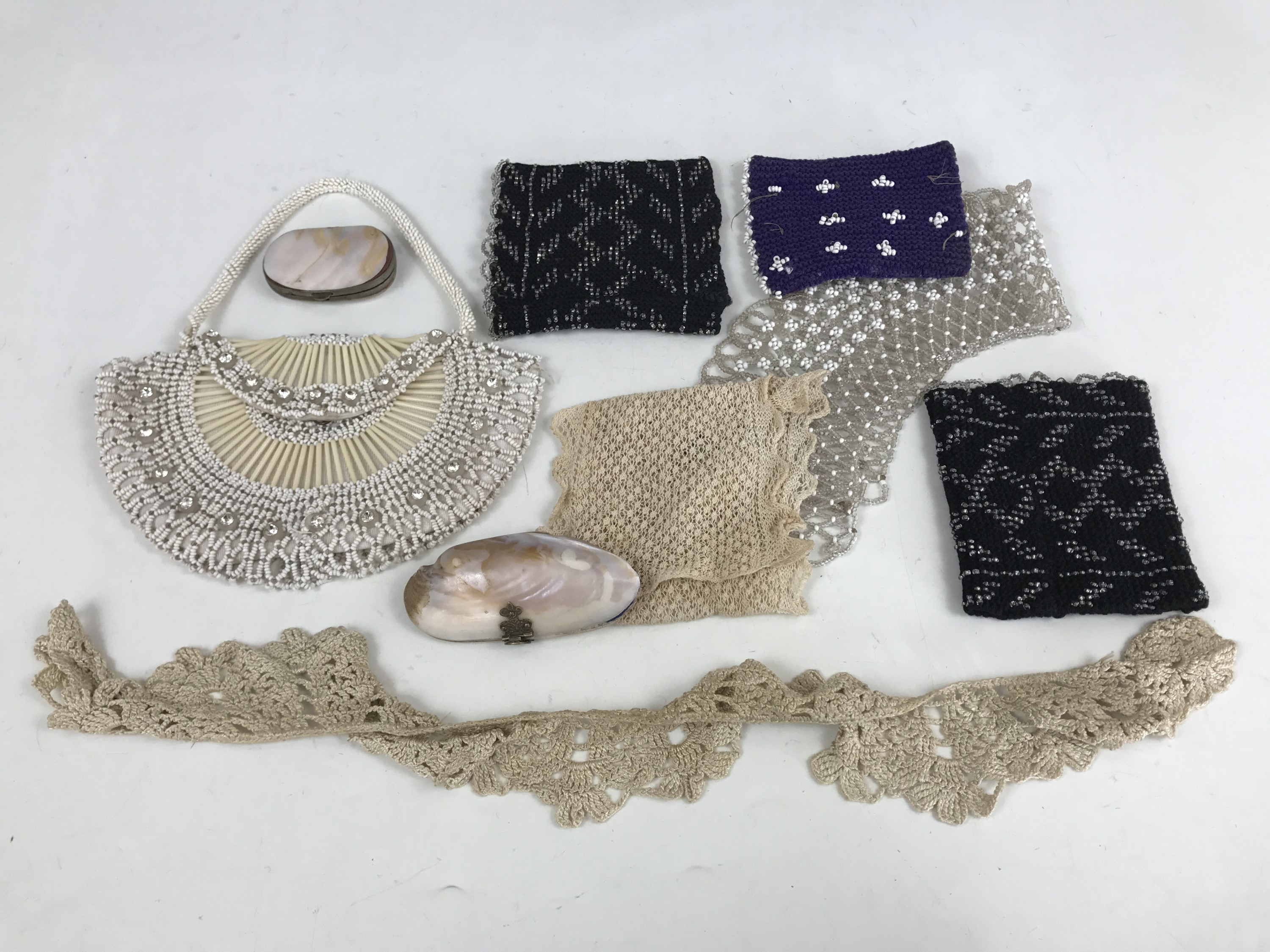 Lot 8 - Victorian costume accessories including beadwork embroidered cuffs, two shell coin purses, beaded