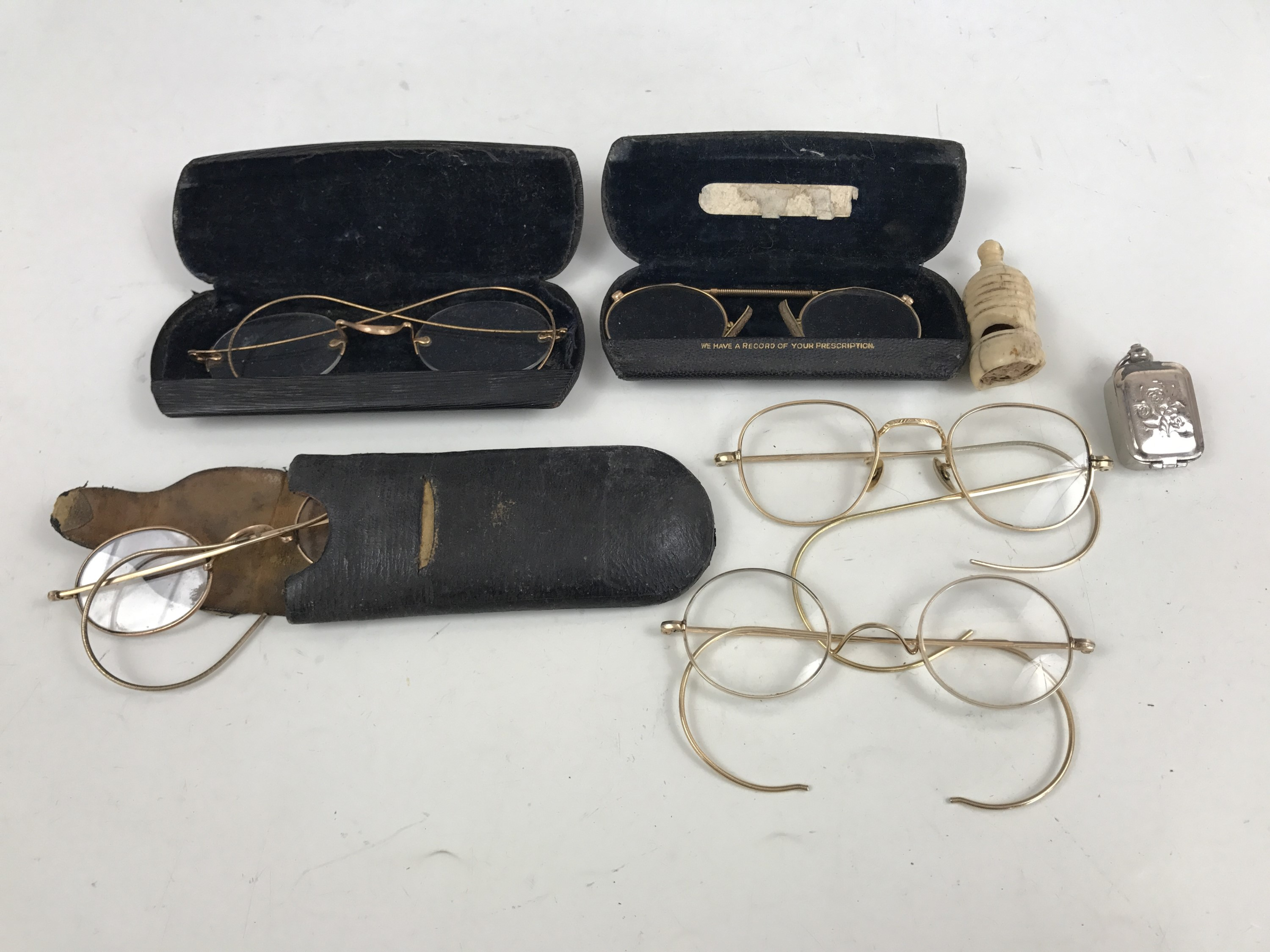 Lot 9 - Collectors' items including late 19th / early 20th Century reading glasses, a carved bone whistle,