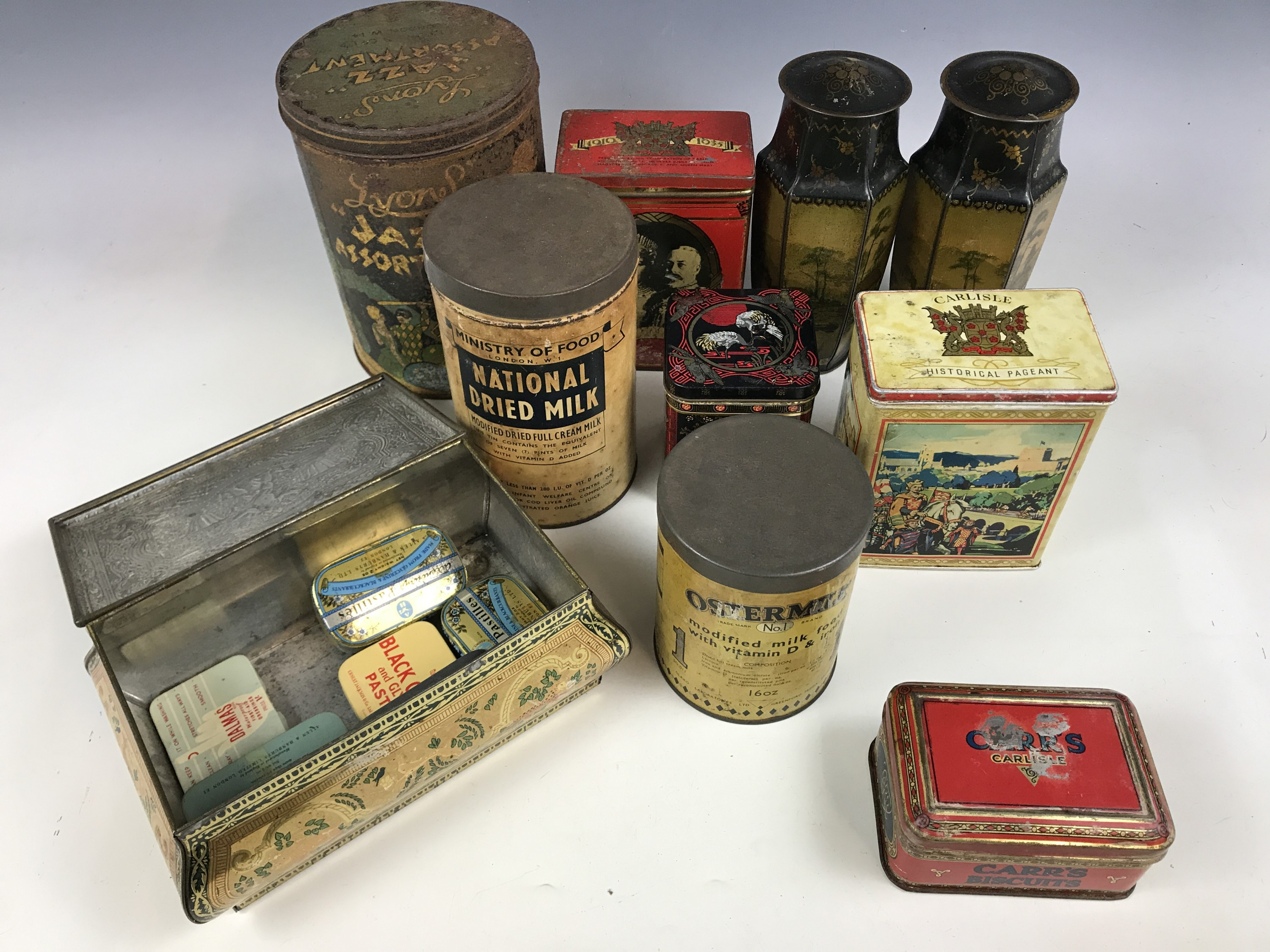 "Lot 32 - A number of vintage tins, including a 1920s Lyons ""Jazz Assortment"" sweet tin and a Second World War"