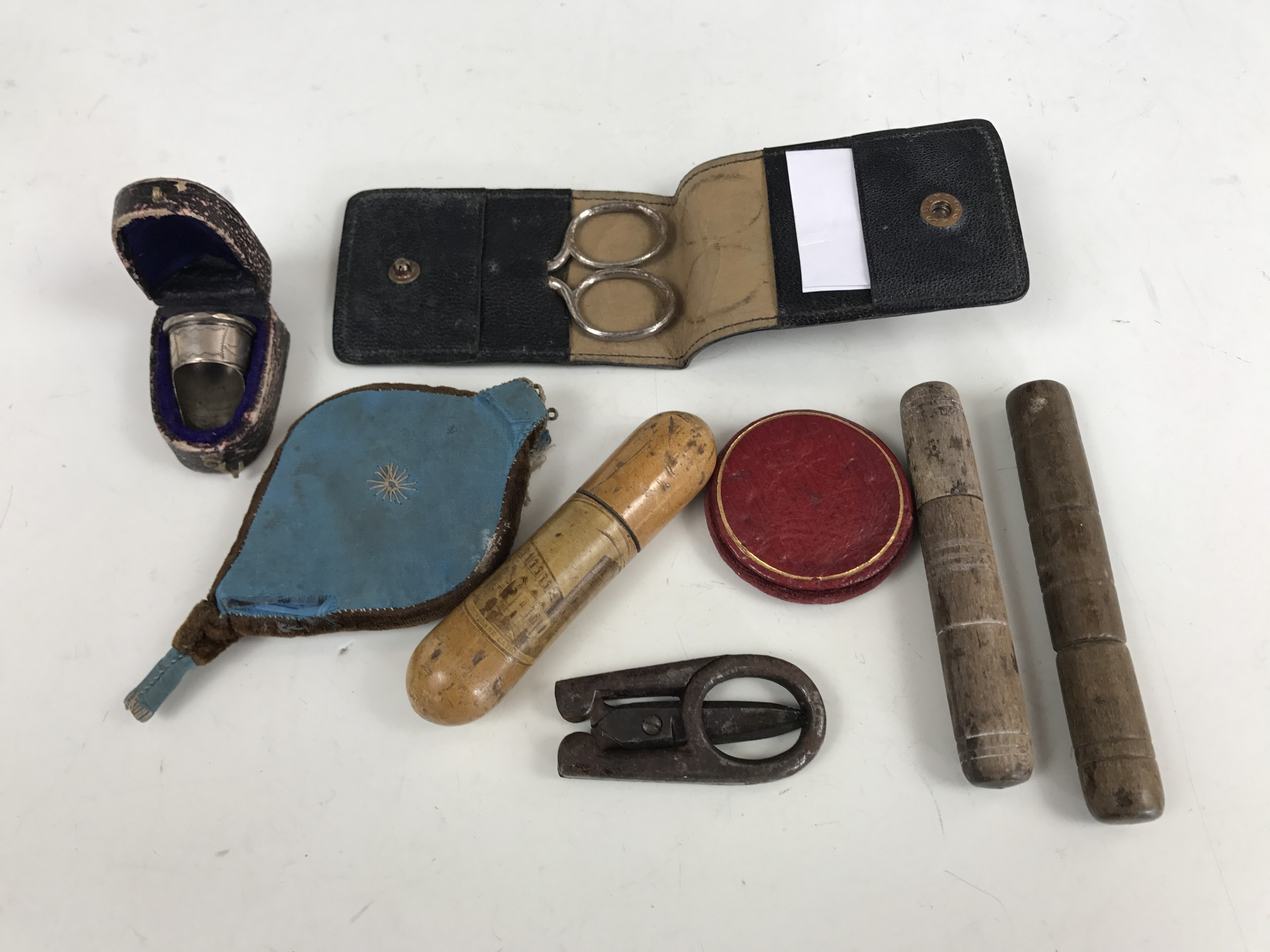 Lot 7 - 19th Century sewing instruments including a Mauchline Ware needle case bearing a view of Dunblane