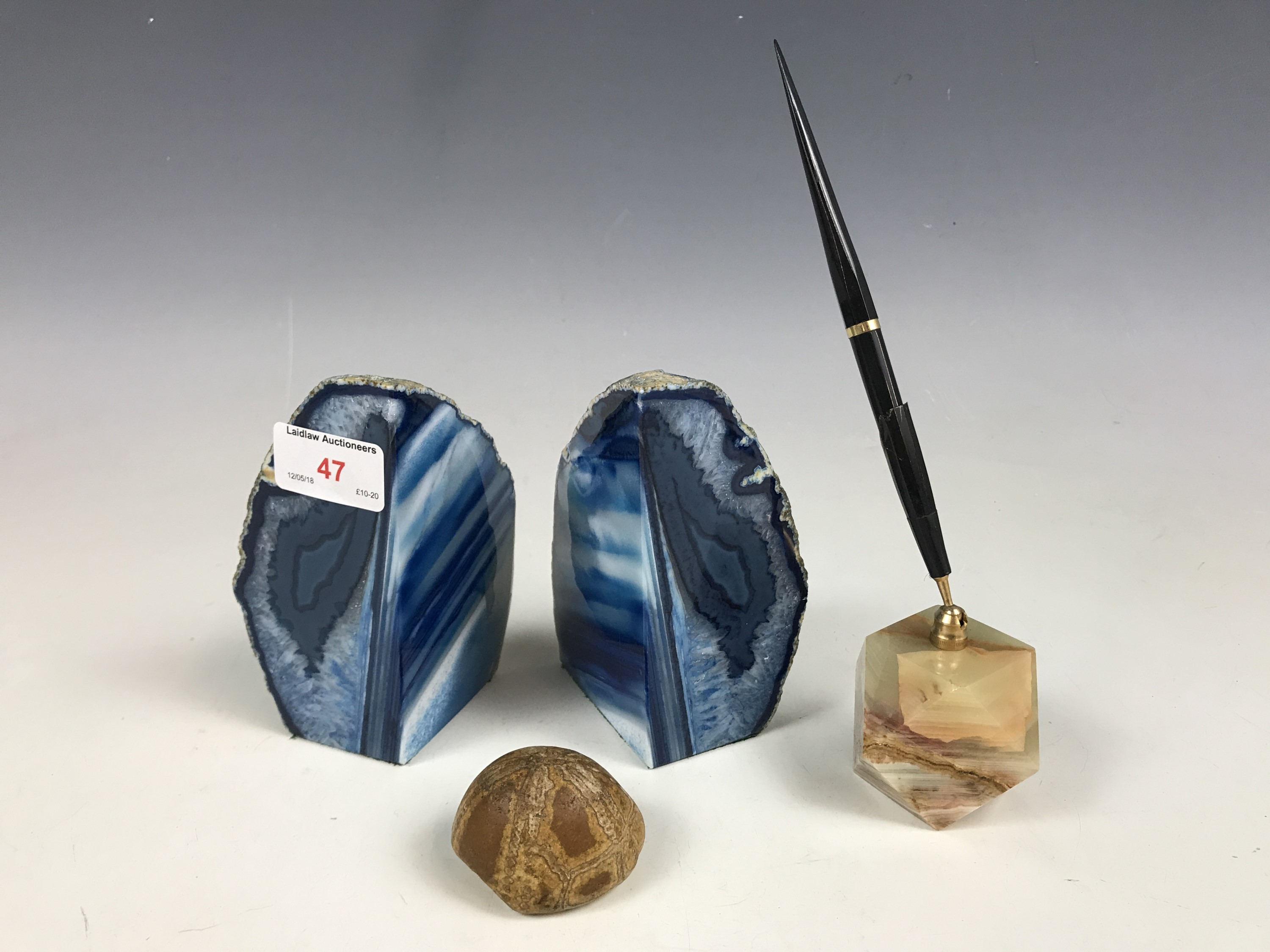Lot 47 - A pair of blue agate bookends, together with a pen holder etc.