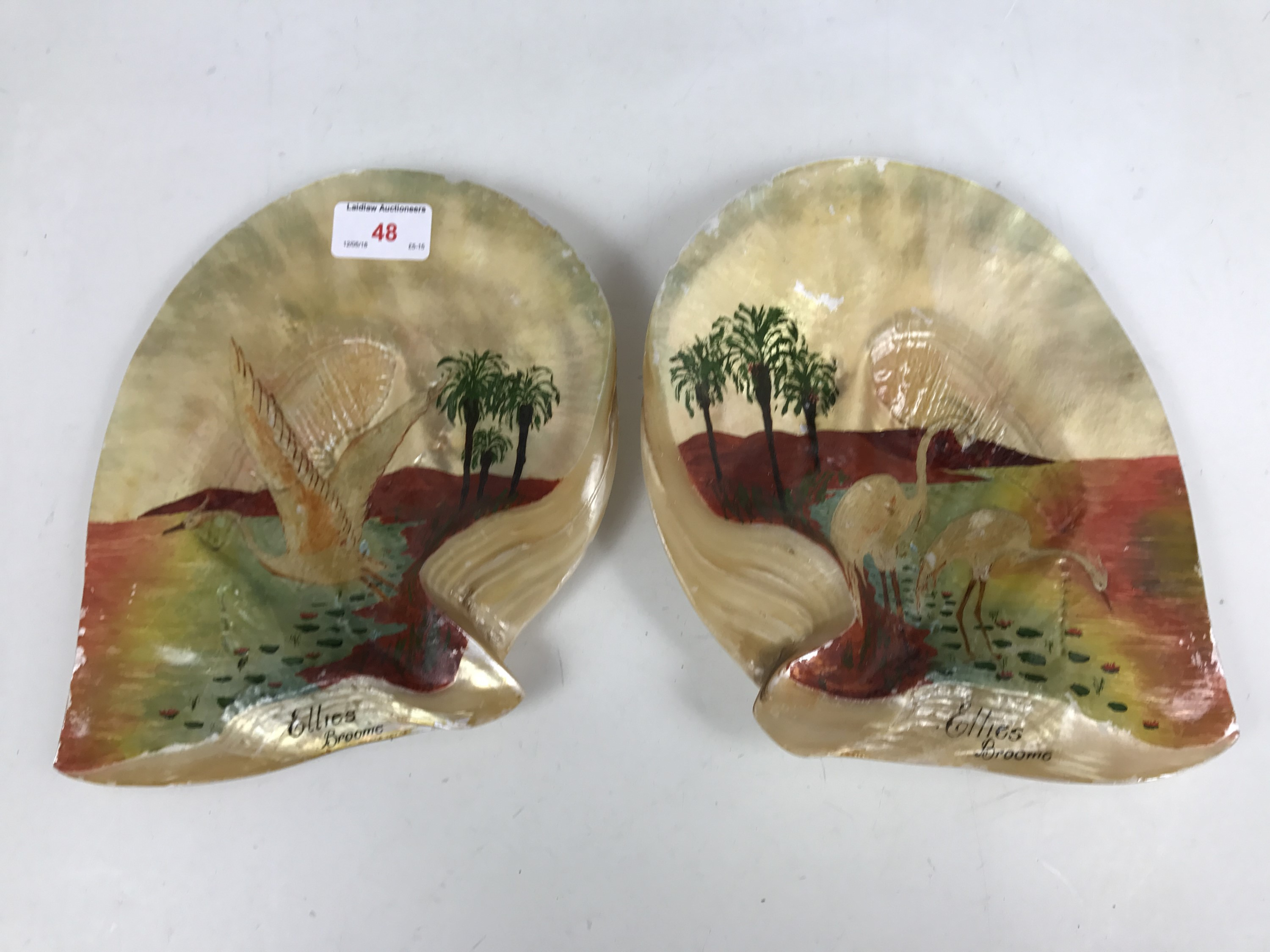 "Lot 48 - A pair of hand-decorated shells bearing the inscription ""Ellie's Broome"""