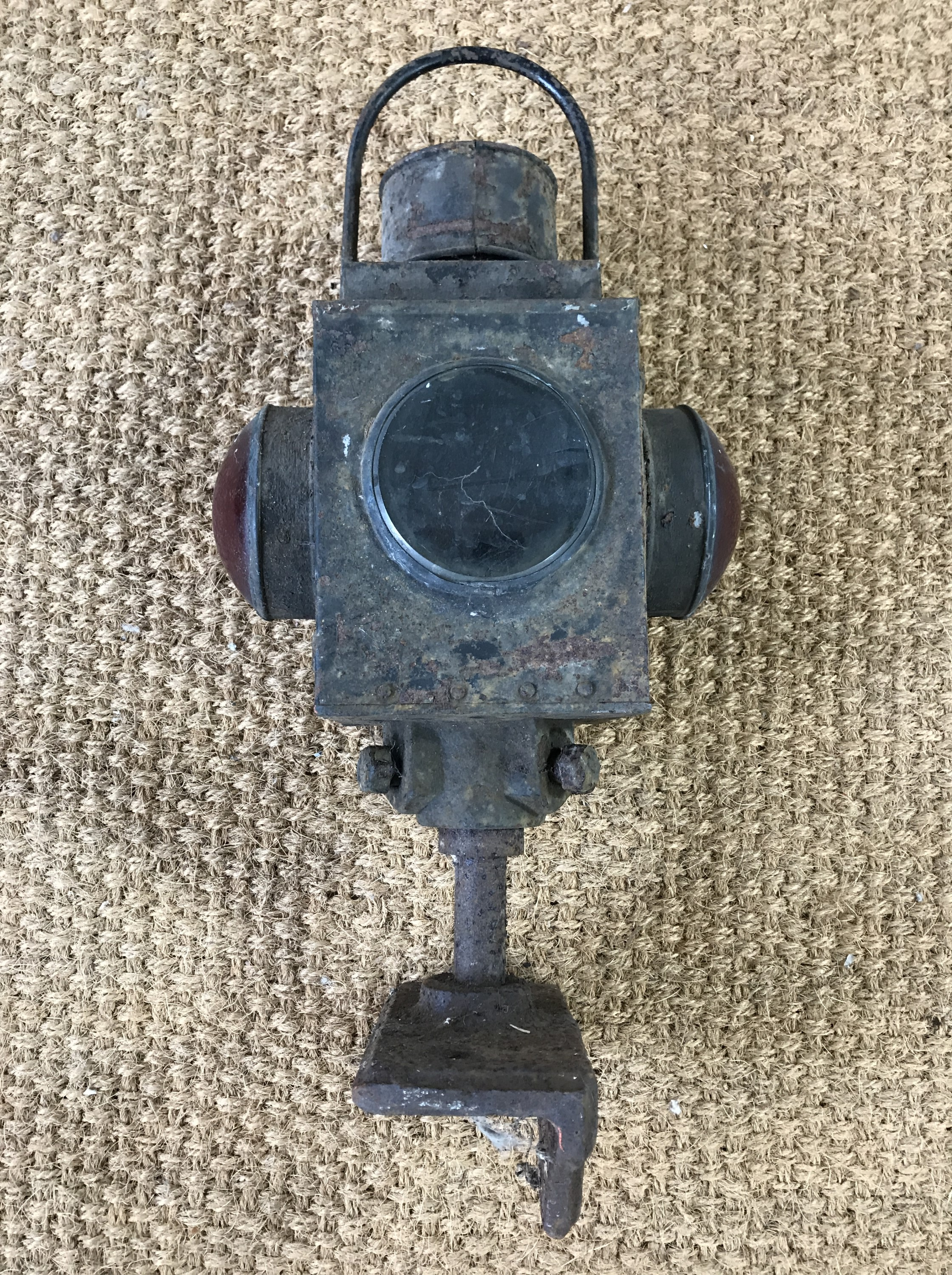 Lot 61 - A late 19th / early 20th Century railway level crossing oil / paraffin lamp and mount
