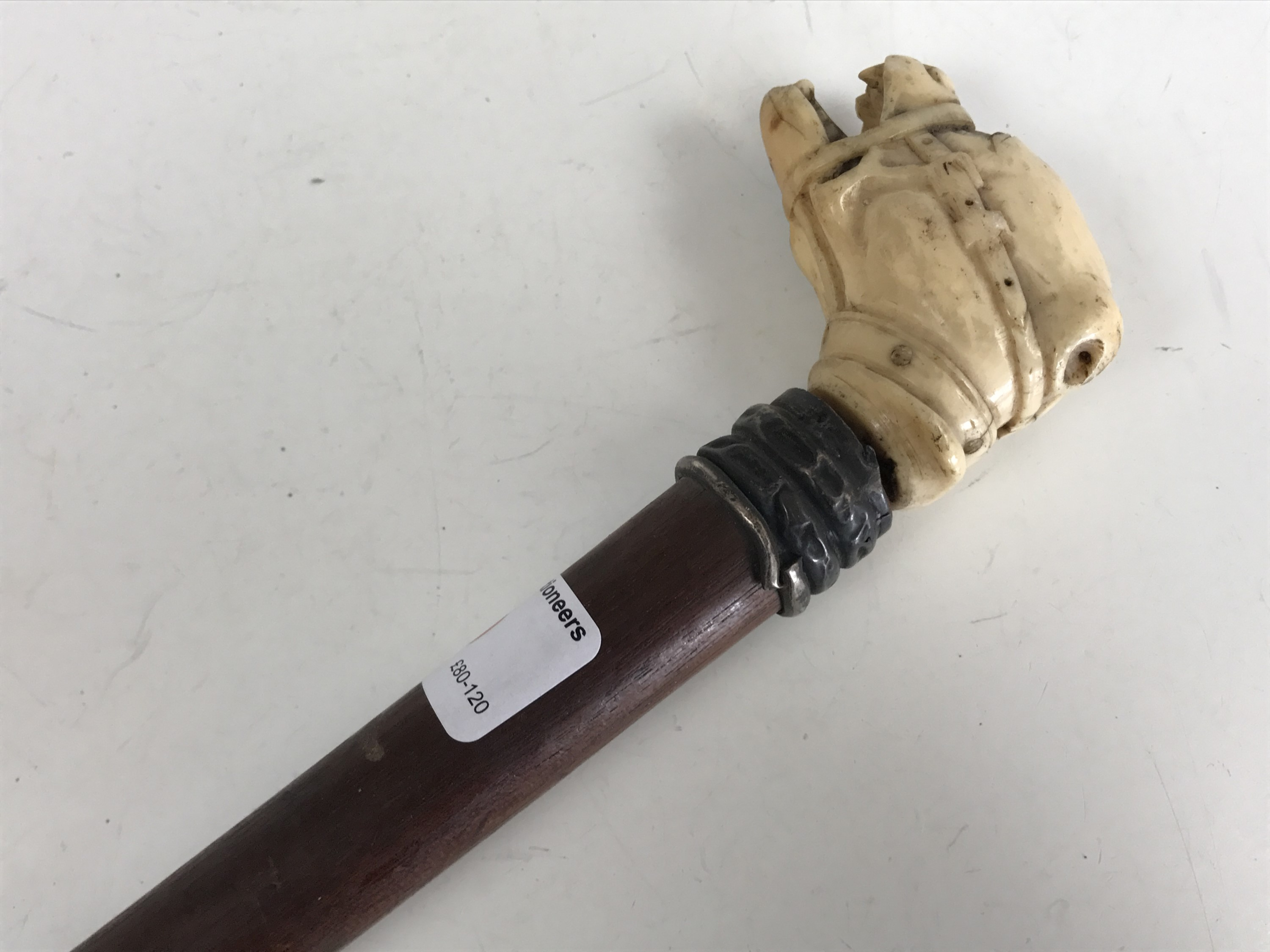 Lot 30 - A Victorian walking cane with ivory pommel carved as a snarling dog's head