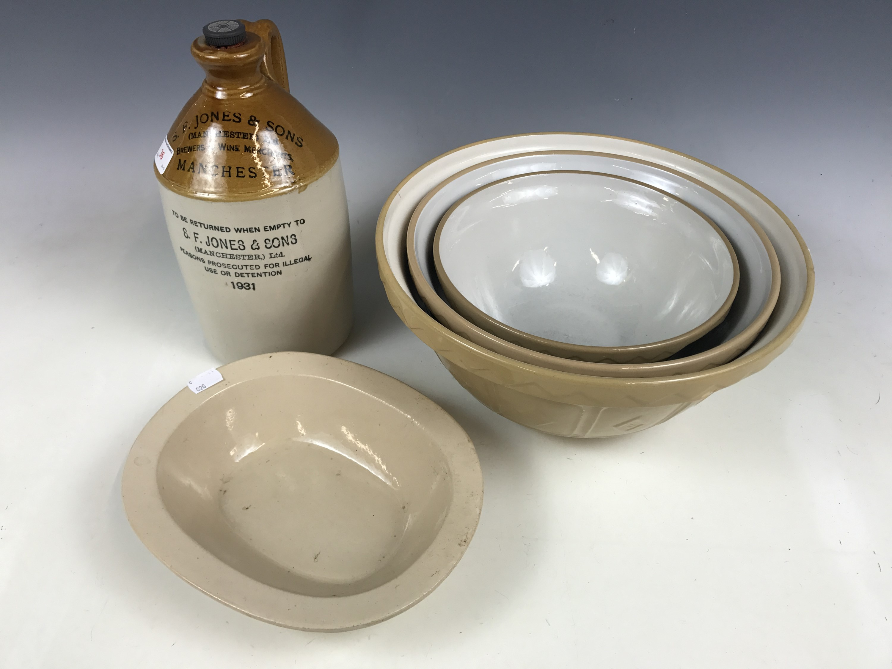 Lot 36 - An S.P Jones and Sons of Manchester stoneware flagon, together with period mixing bowls