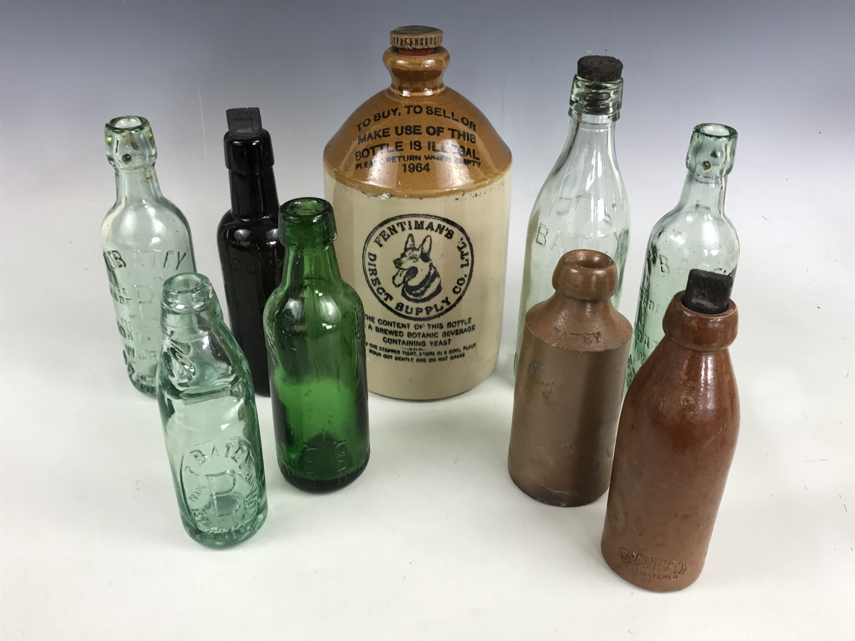 Lot 49 - A Fentiman's stoneware flagon, together with two Thomas Batey of Brampton stoneware ginger beer