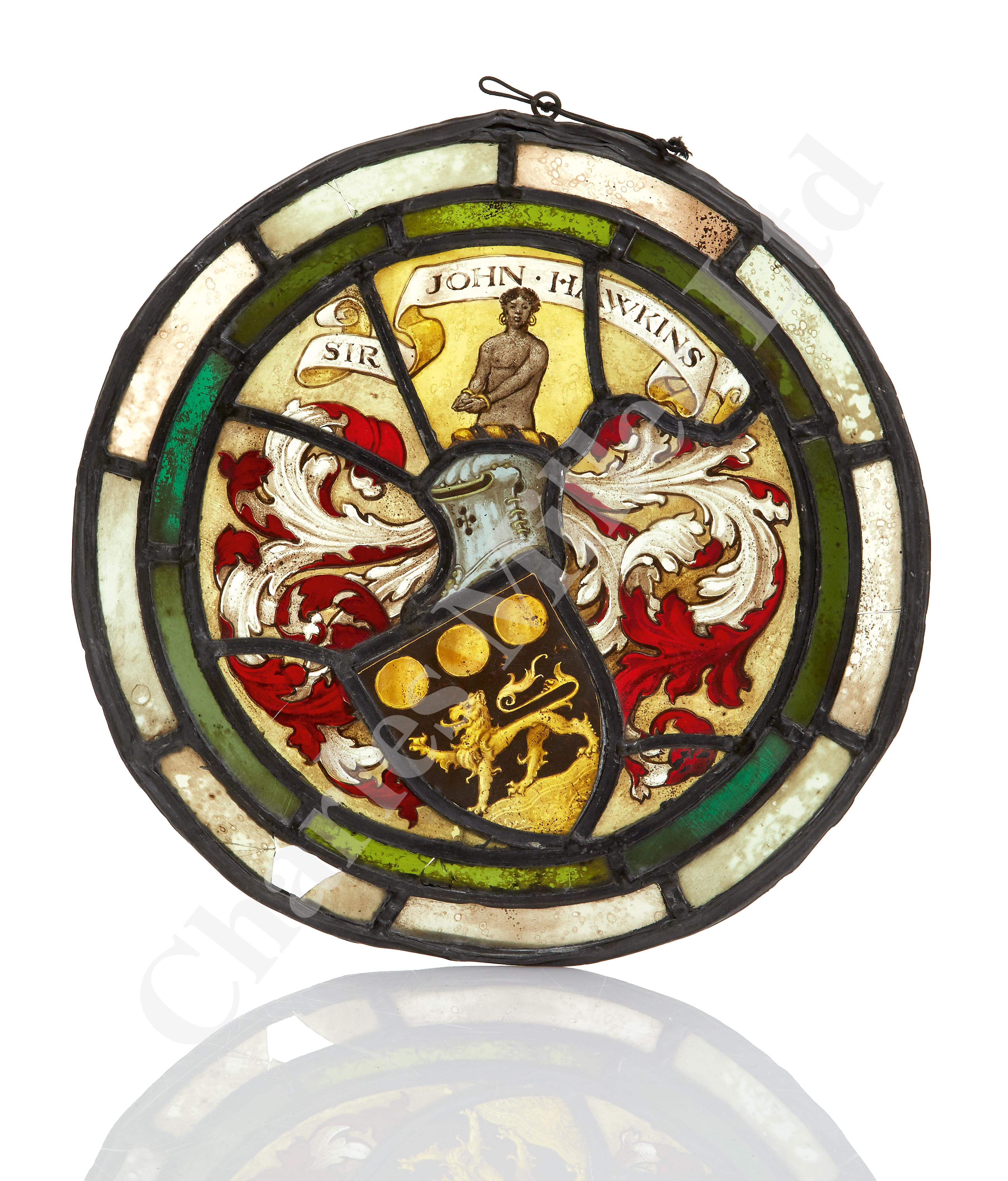 Lot 208 - A 19TH CENTURY STAINED GLASS ROUNDEL BEARING THE ARMS OF ADMIRAL SIR JOHN HAWKINS