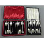 A cased set of six London silver teaspoons and sugar tongs together with a cased set of six