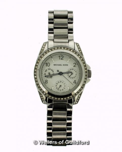 Lot 5016 - *Ladies' Michael Kors wristwatch, circular cream dial with white stone set bezel, Arabic numerals