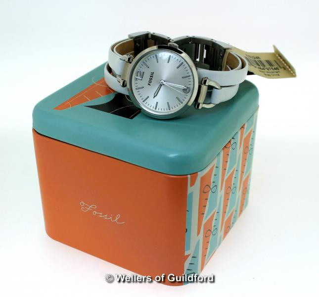 Lot 5043 - *Ladies' Fossil wristwatch, circular white dial with baton hour markers, on white leather strap,