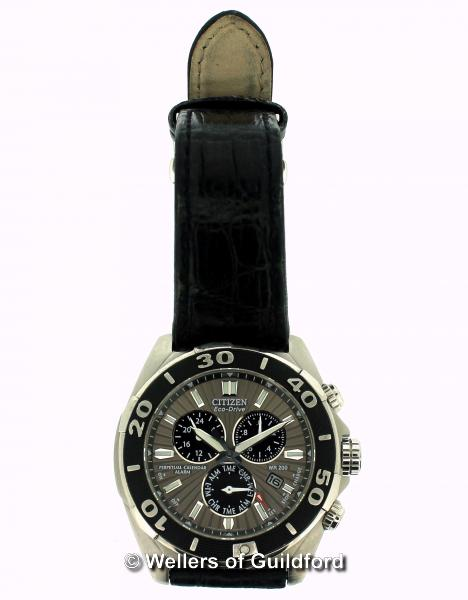 Lot 5001 - *Gentlemen's Citizen Eco-Drive Perpetual Calendar Alarm wristwatch, circular silvered and black