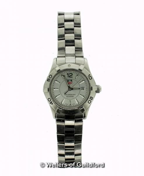 Lot 5018 - *Ladies' Tag Heuer Aquaracer wristwatch, circular silvered dial with rotating bezel, baton hour
