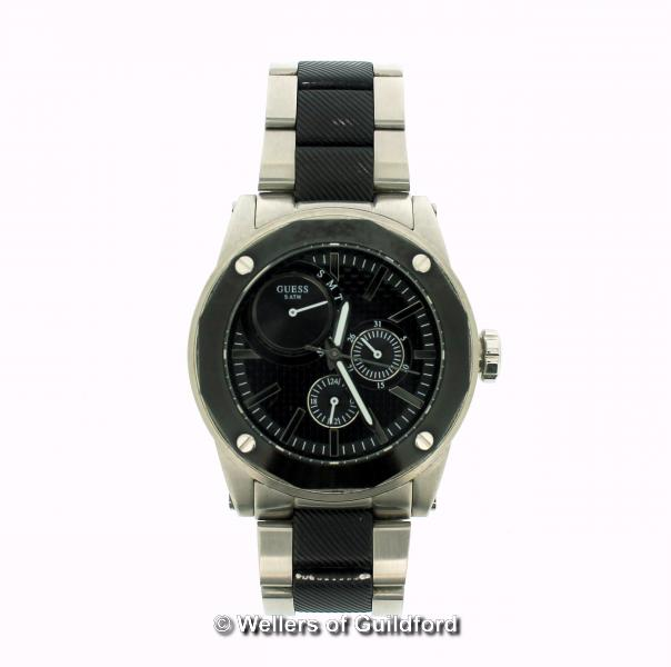Lot 5047 - *Gentlemen's Guess two-tone stainless steel wristwatch, circular black dial, with baton hour markers