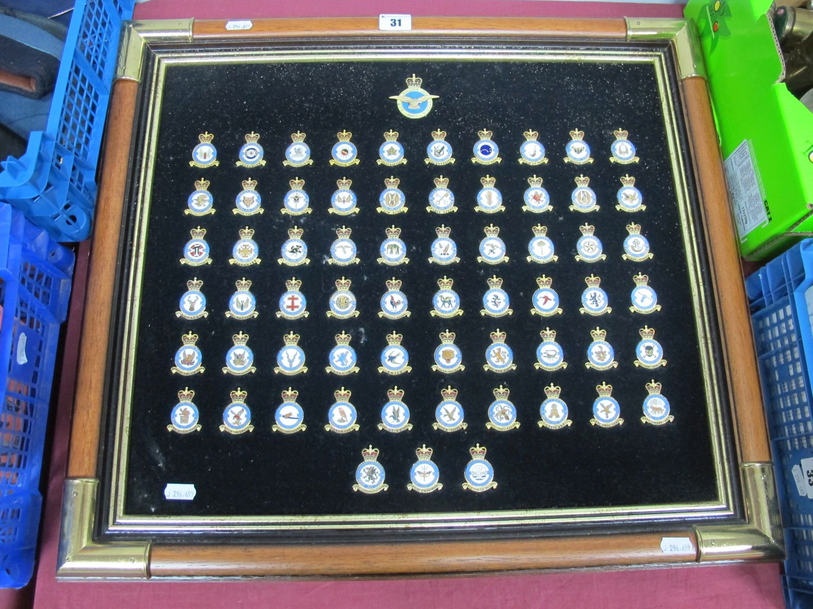 Lot 31 - A Framed Collection of Sixty Five RAF Squadron Badges, 59cm x 53cm.