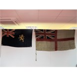 A Royal Navy White Ensign, 87 x 170cm, and a blue ensign with golden lion, 75cm by 130cm.