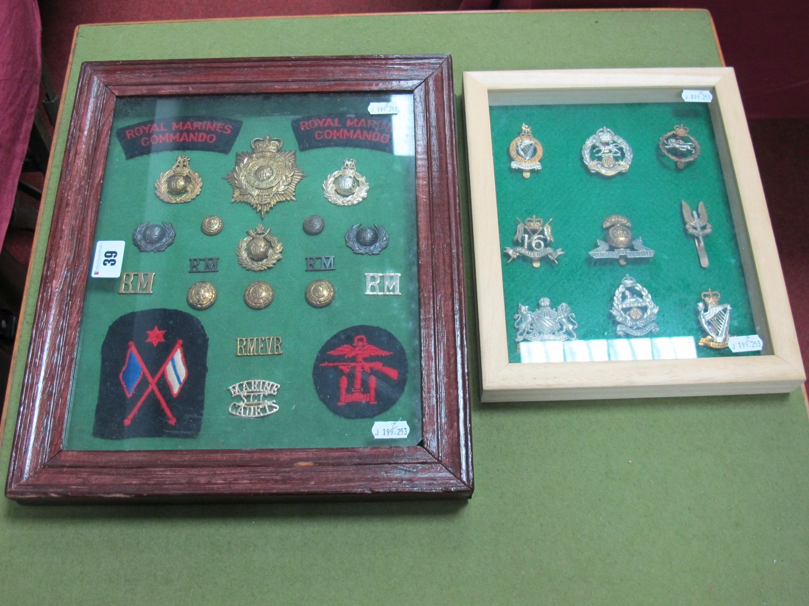 Lot 39 - Two Framed Military Cap Badge, Button and Cloth Patch Collections, including Royal Marines, Irish