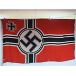 A Third Reich Flag (Nazi), measuring 8ft x 4 ft 6ins, marked REICHSKNEGSFL, complete with Halyard.