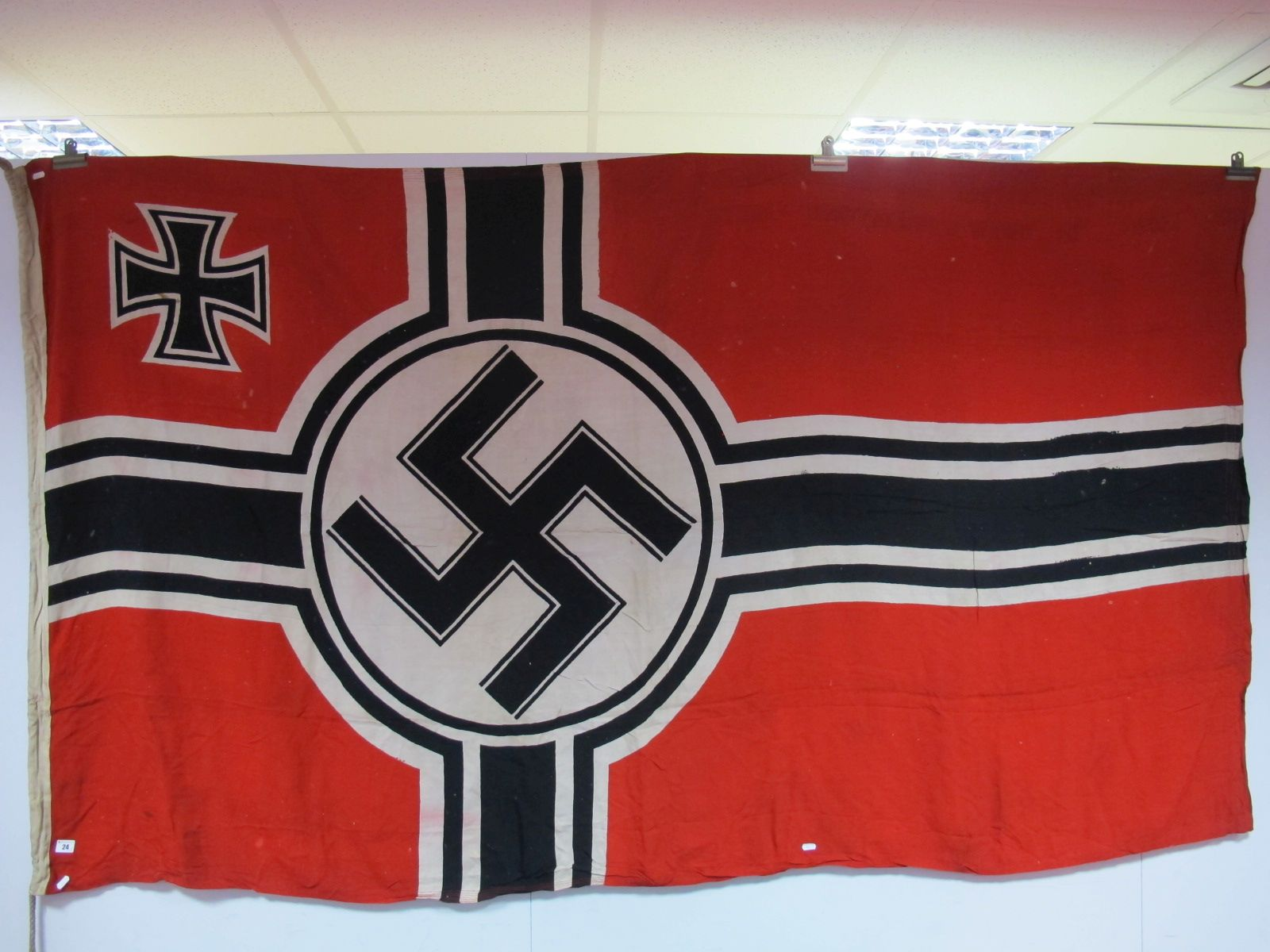 Lot 24 - A Third Reich Flag (Nazi), measuring 8ft x 4 ft 6ins, marked REICHSKNEGSFL, complete with Halyard.