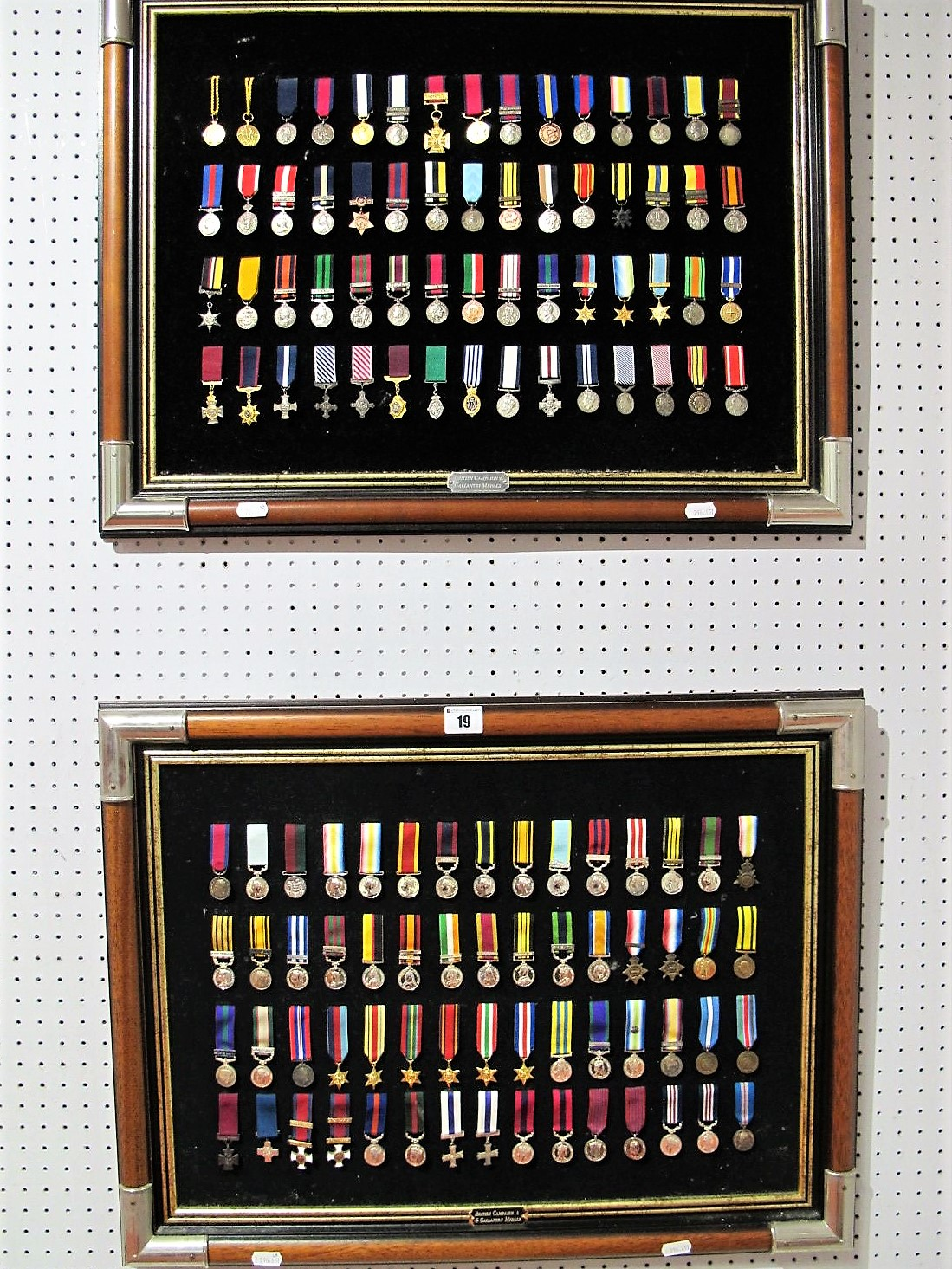 Lot 19 - A Large Collection of British Medal Miniatures, all reproduction on two picture frames.