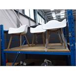3 white plastic tub style chairs with wooden legs