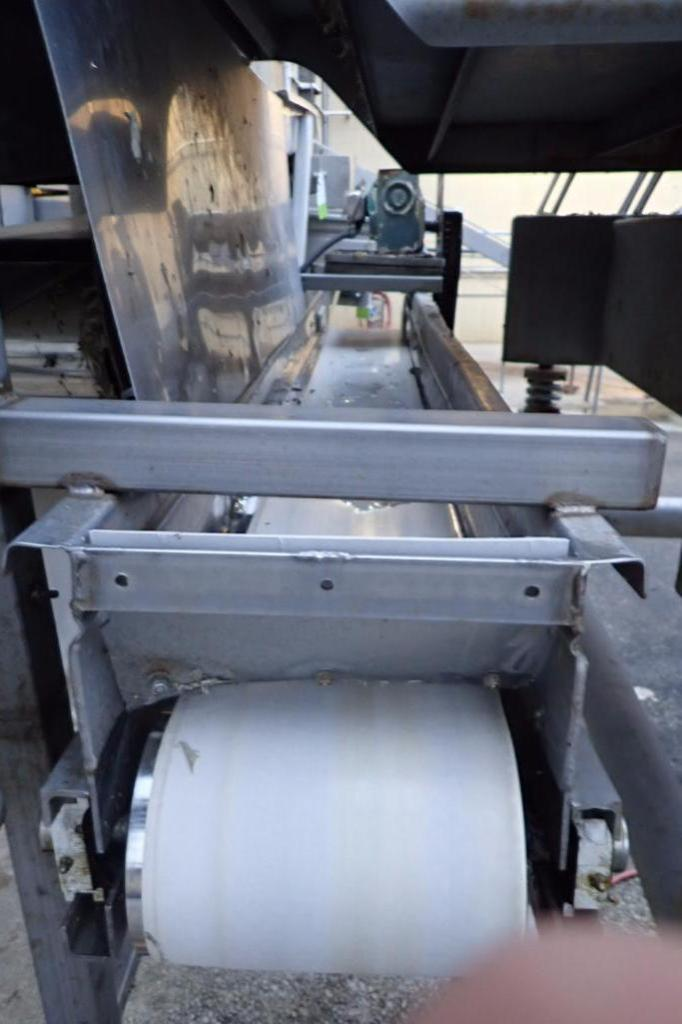 Lot 1006 - Overhead conveyor, 84 in. long x 9 in. wide, vinyl belt, SS frame, motor and drive, no legs ** Riggi