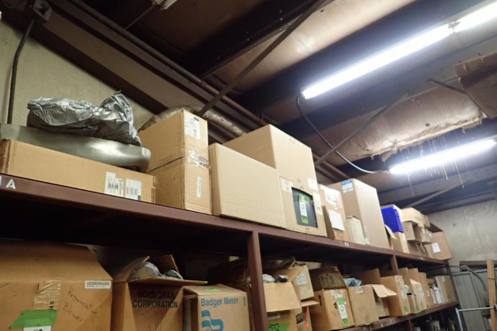 Lot 979 - Contents of upper shelves, poly parts bins, bearing racks, assorted duct hose and drive belts, Linx