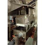Incline conveyor, plastic belt, 112 in. long x 24 in. wide, mounted on SS holding tank, 96 in. long