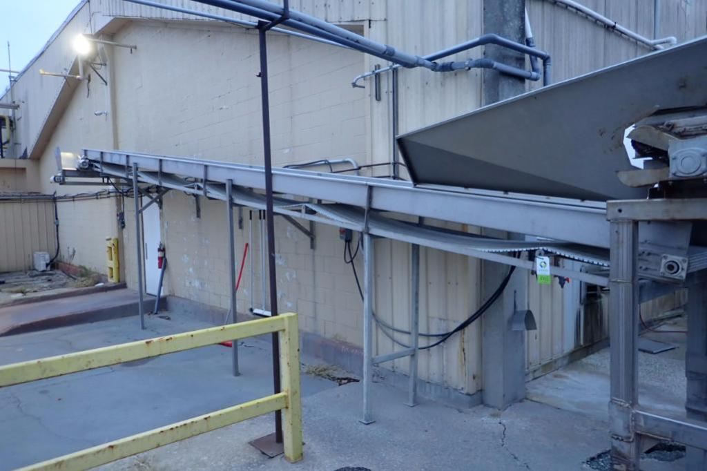 Incline conveyor, 35 ft. long x 24 in. wide x 60 in. infeed x 108 in. discharge, SS frame, motor and