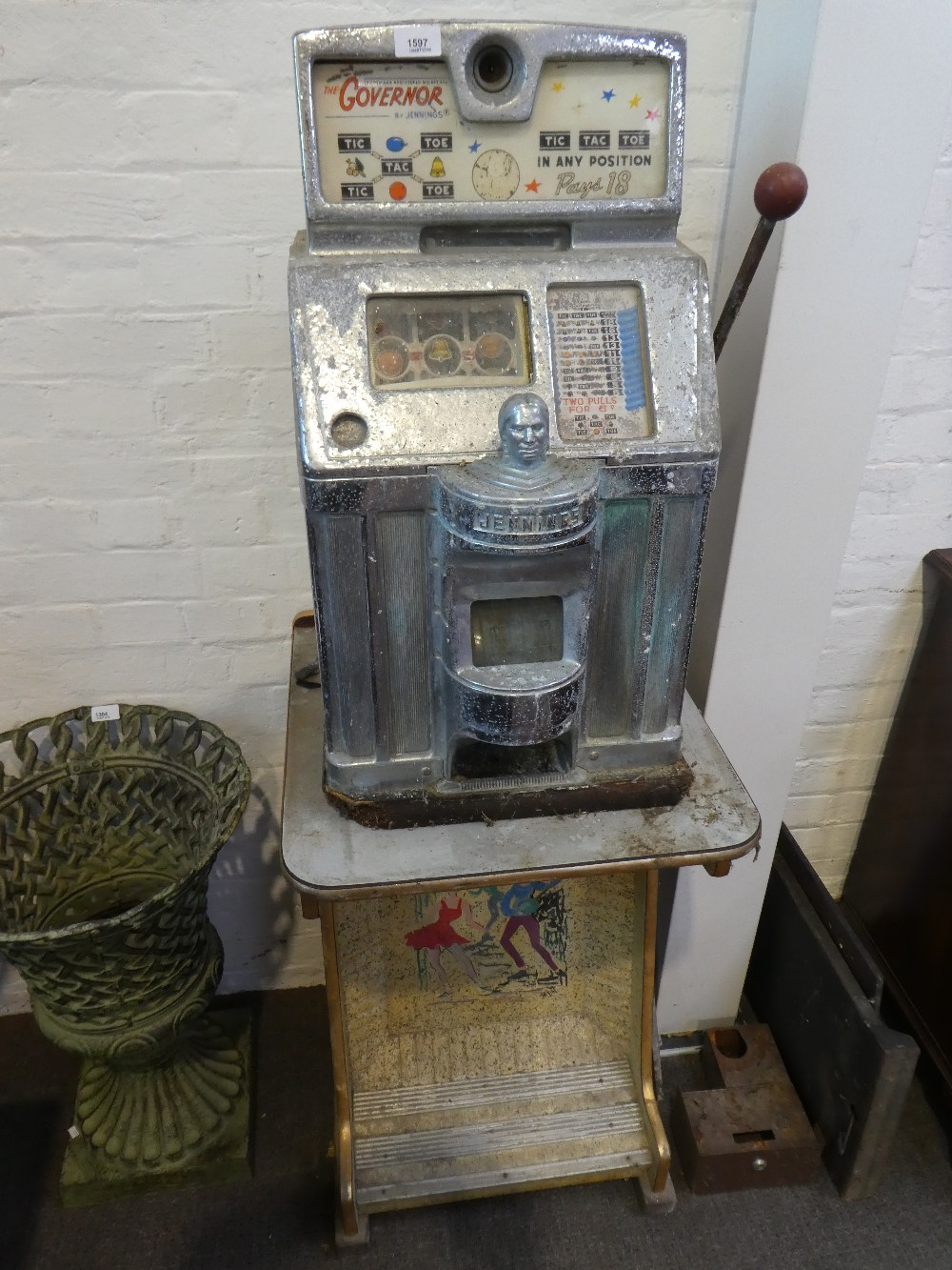 The Governor Sun Chief slot machine by Jennings and Co circa 1960 with stand having footr from